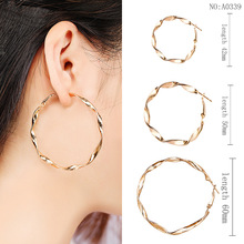 цена на Korean temperament alloy hoop earrings for women twisted personality simple popular gold earrings H29