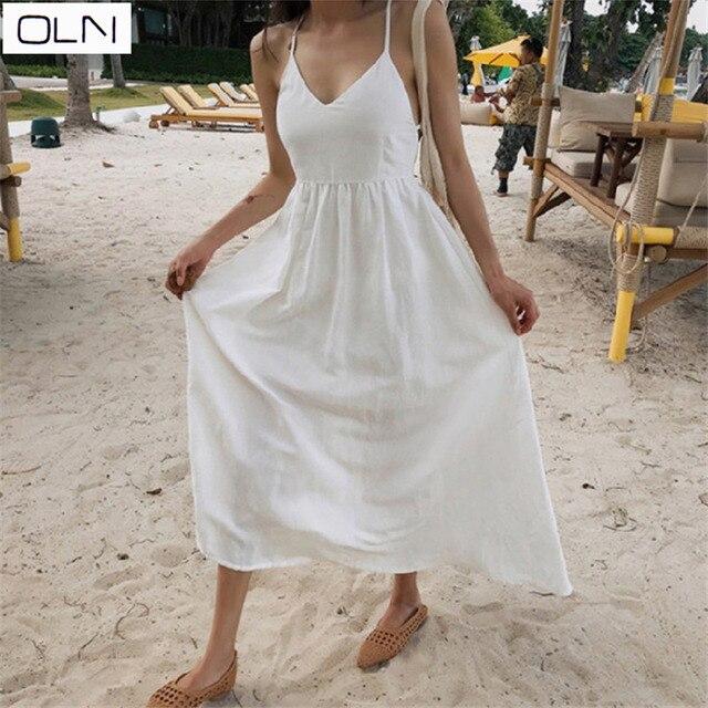 Dongdaemun 2019 spring cold light solid color bottoming dress sleeveless halter strap dress big swing  beach dress