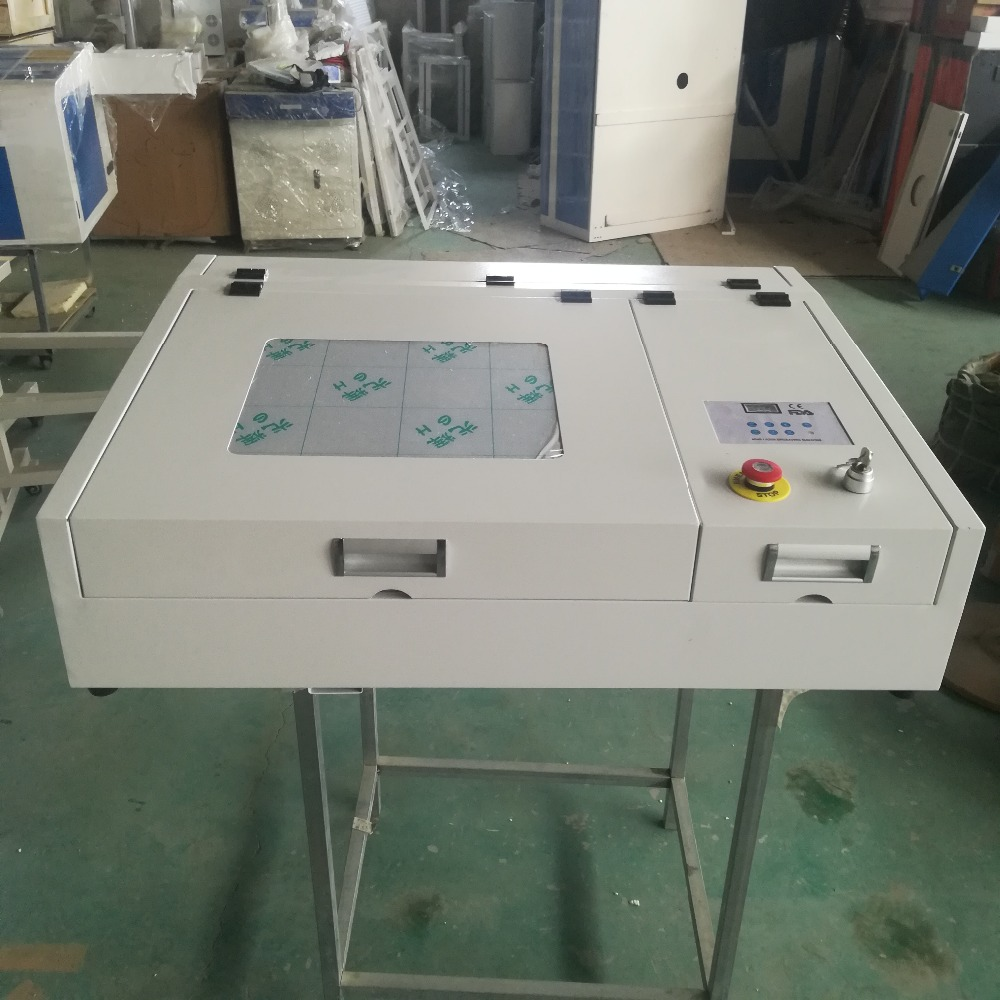 HTB1P0EFXynrK1Rjy1Xcq6yeDVXa5 - 4040 laser engraving and cutting machine with 50w CO2 laser tube and gold laser head deliver by DHL or TNT or fedex to your door