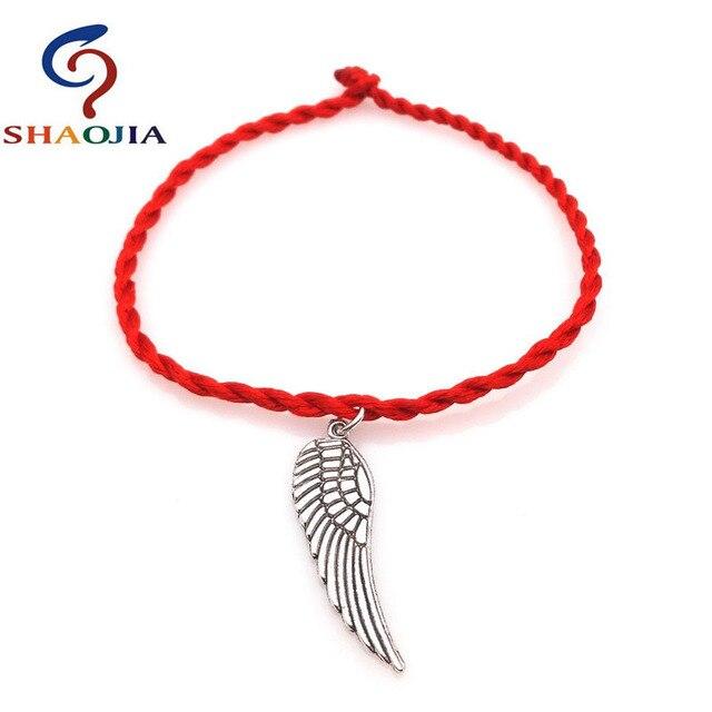 5630ac0252b9 ¡10 estilo pulsera roja! Esqueleto pluma ala paz Cabeza de Buda trébol rojo  pulsera