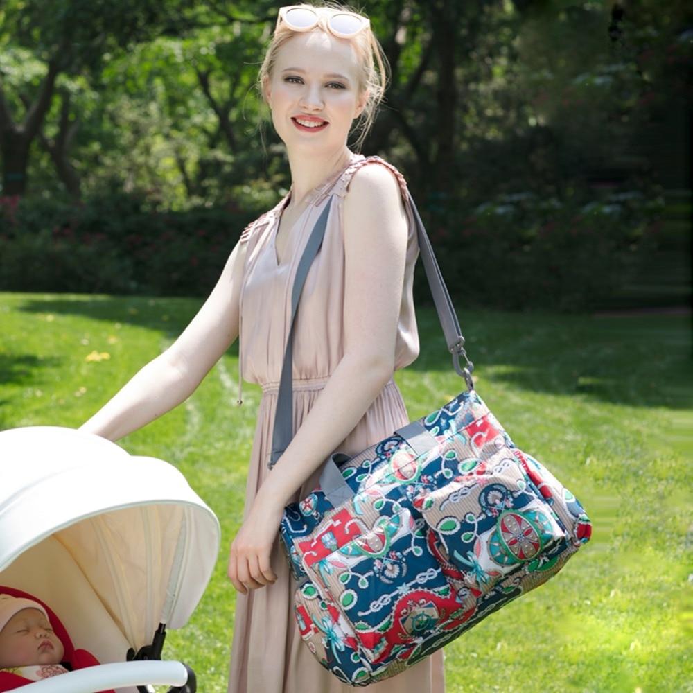 Image 5 - Многофункциональная водонепроницаемая сумка для беременных и для подгузников, большая вместительность, модная сумка для мам, сумки для кормления детей, сумка на колесиках-in Сумки для подгузников from Мать и ребенок