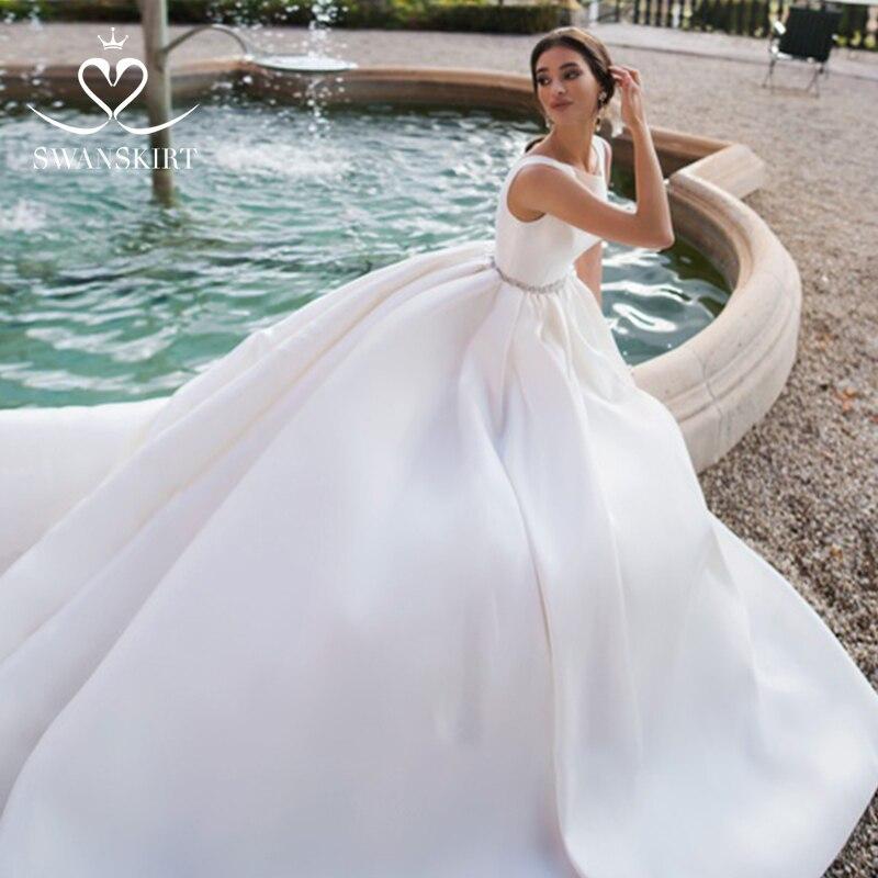 Swanskirt Luxury Satin Wedding Dress 2019 New Crystal Belt Backless A Line Princess Court Train Bride Gown Vestido de Noiva K167-in Wedding Dresses from Weddings & Events