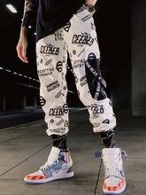 купить Color Block Pocket Patchwork Cargo Joggers Men Graffiti Hip Hop Letter Print Harem Pants Mens Casual Dance Trousers Sweatpants по цене 1299.37 рублей