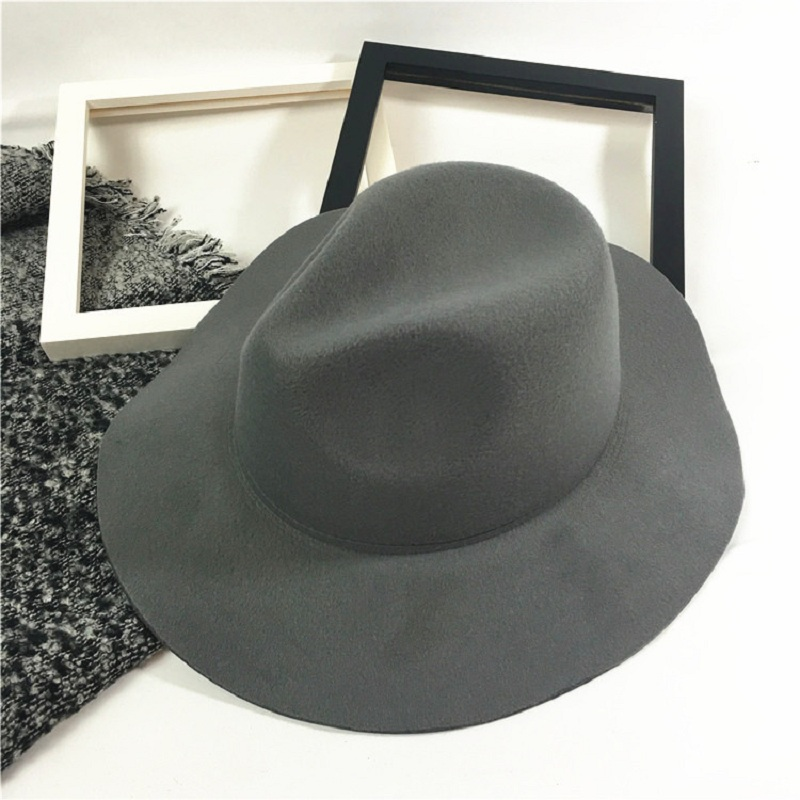 Fashion Unisex Wool Felt Hats With Wave Wide Brim Stylish Fedora Hat Panama  Caps Chic Solid Trilby Cap For Men And Women ff5b2325664