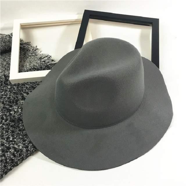 07a9f83a09d6 Gorros de fieltro de lana Unisex a la moda con ala ancha de onda elegante  sombrero Fedora gorras de Panamá gorra de Trilby sólida Chic para hombres  ...