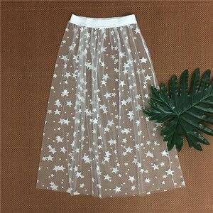 Image 2 - Herfst Winter Vrouwen Mesh Hollow Out Rokken Fashion Casual Elegant Lace Transparante Rok Sterren Overrok Midi EEN Lijn lange Rok