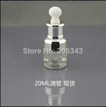 NEW ARRIVAL 20ml transparent glass dropper bottle with silver shoulder and silver collar ,white bulb glass bottle