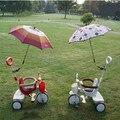 El pie del bebé triciclo de niños presenta un parasol coche de juguete cochecito bicicleta de los niños