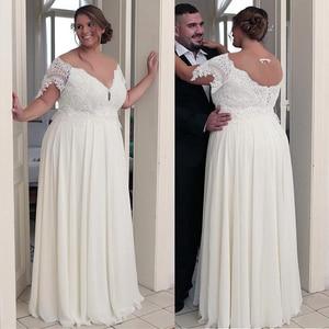 Image 1 - Unique Chiffon Jewel Neckline A line Plus Size Wedding Dresses With Beaded Lace Appliques Short Sleeves Bridal Gown