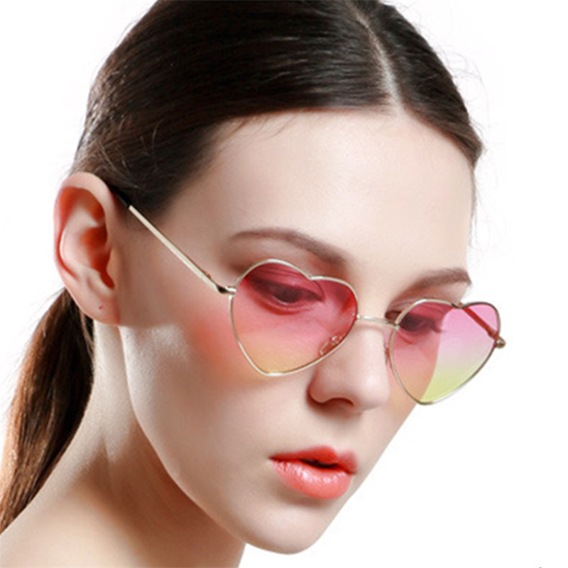 Trend glasses Europe and the United States original single big ladies sunglasses reflective gradient peach heart-shaped GG101