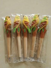 Promotional high quality wood craft yellow green ballpoint pen basswood bird gift handmade carved colored