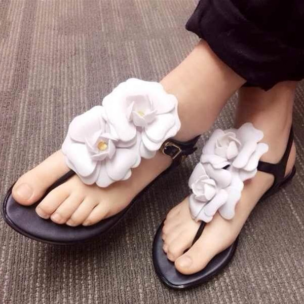 The new summer Women camellia plastic jelly shoes  sandals flat bottom beach shoes free shipping candy color jelly sandals new plastic chain beach shoes chain flat bottomed out sandals lace up chains women shoes