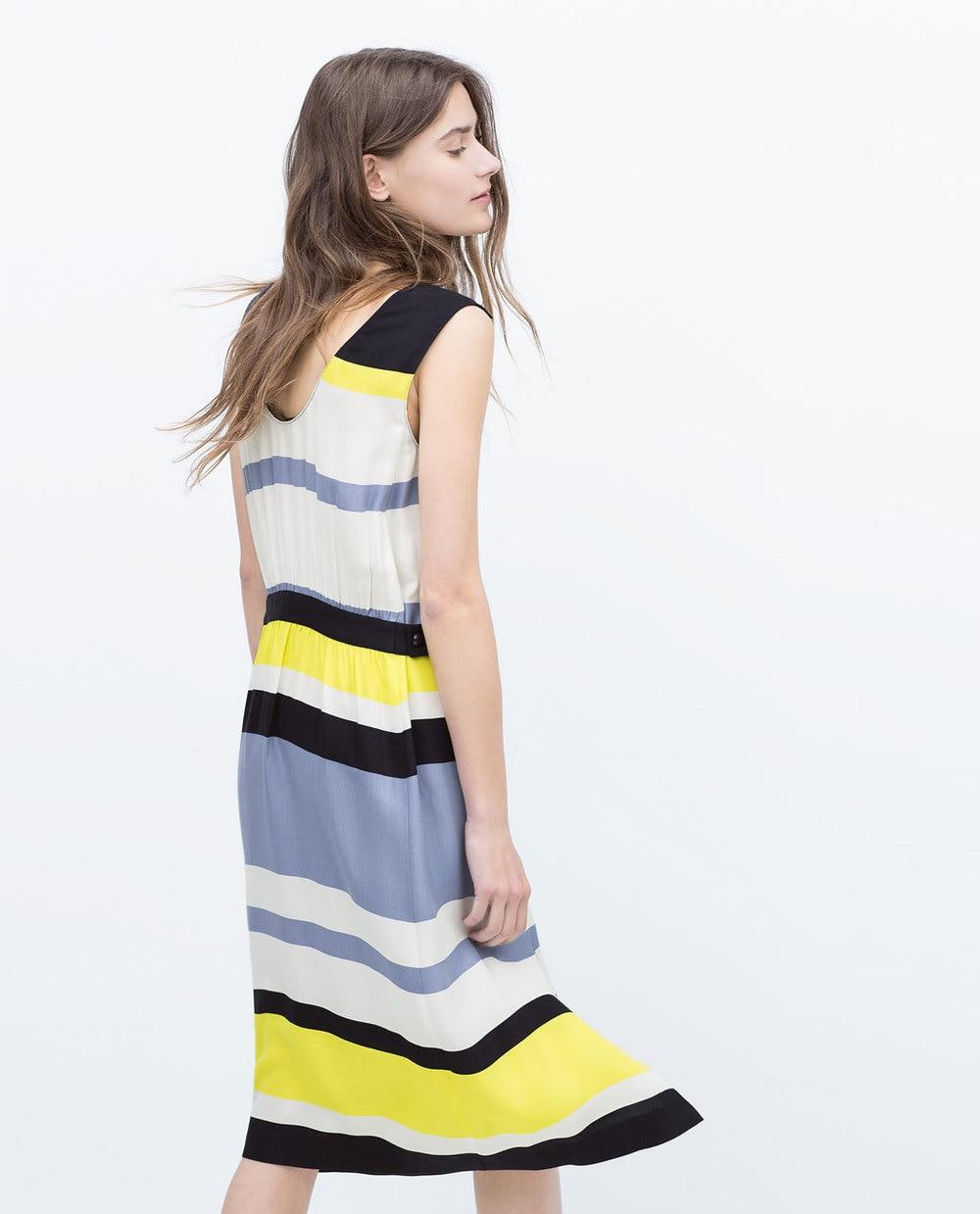 Robe jaune blanc bleu noir