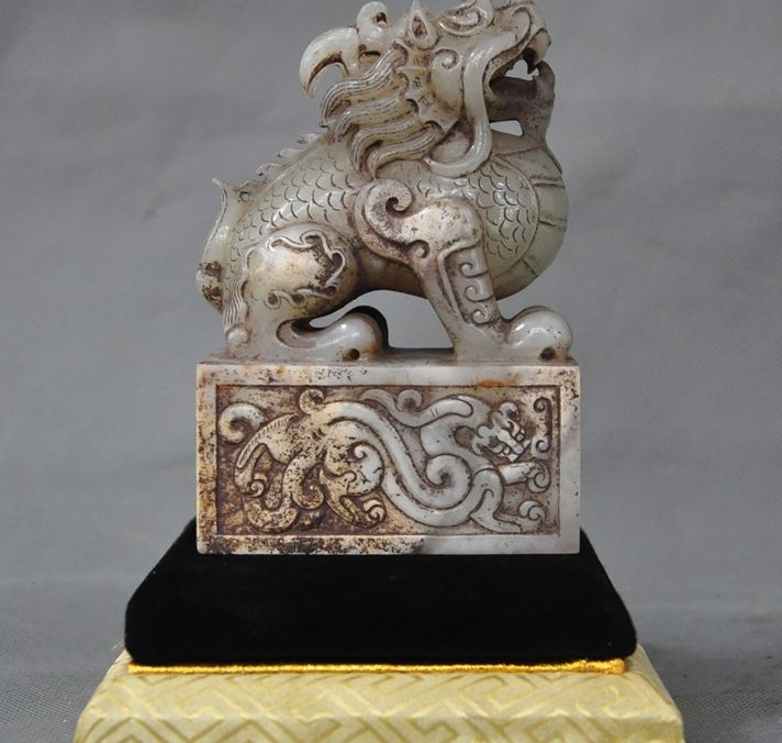 A pair of rich Chinese jade kirin fu feng shui to ward off bad luck dog statues