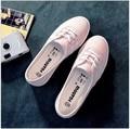La raya del verano de fondo plano es belle mayores envolver pedal zapatos de lona bajos descansaban zapatos de algodón hecho a zapatos femeninos