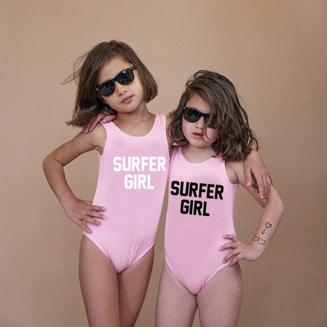 4cdf219502 Cute Swimwear One Piece Swimsuit Summer Beachwear Letter Print SURFER GIRL Kids  Bathing Suit Swimming Children Pink Black Girls