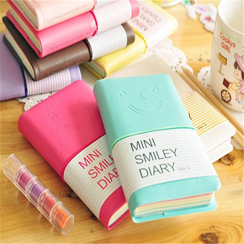 Wholesales 1pcs 13*8.5CM Creative Random Delivery Smile Diary Notebook  School Leather Notebook For Girls Drop Shoping