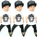 2016 cabritos del bebé de la muchacha del muchacho ropa impresos esfinge Tops T-shirt de cuero de imitación pantalones trajes Set 1-5Y