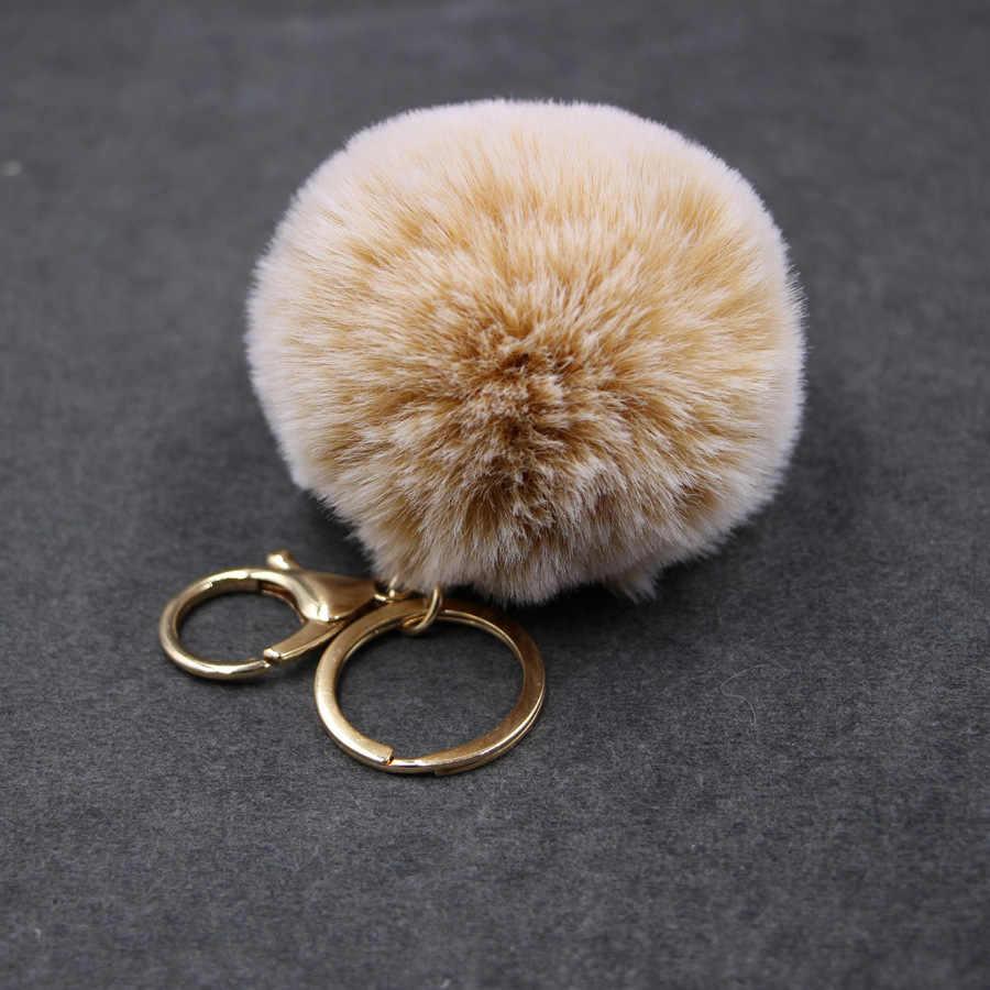 LLavero de pompón de piel de imitación de cuero grande 8 CM bolsa de bombilla de pelo de conejo BOLA DE pompón llavero colgante de poret clef para mujeres encantador mullido