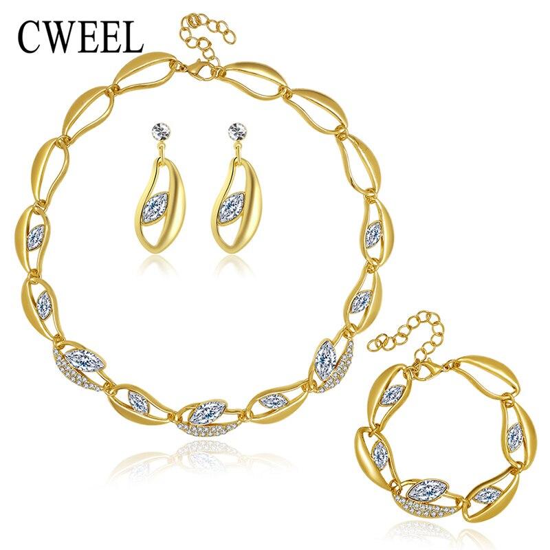 f7fbd34c0f43 Cweel nueva Africana Cuentas Juegos de joyería para las Mujeres Partido de  oro de color imitado cristal colgante collar Pendientes Accesorios de boda .