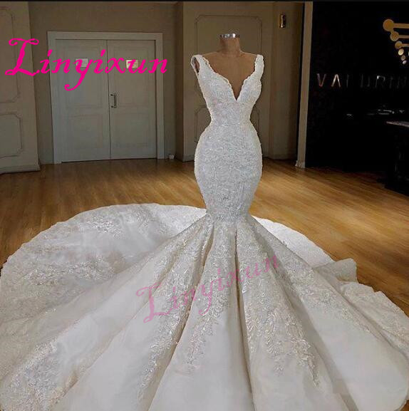 Dubai Sexy Corset Mermaid Wedding Dresses Deep V Neck Sleeveless Lace Appliques Wedding Gowns 2018 Sweep Train Bridal Dress