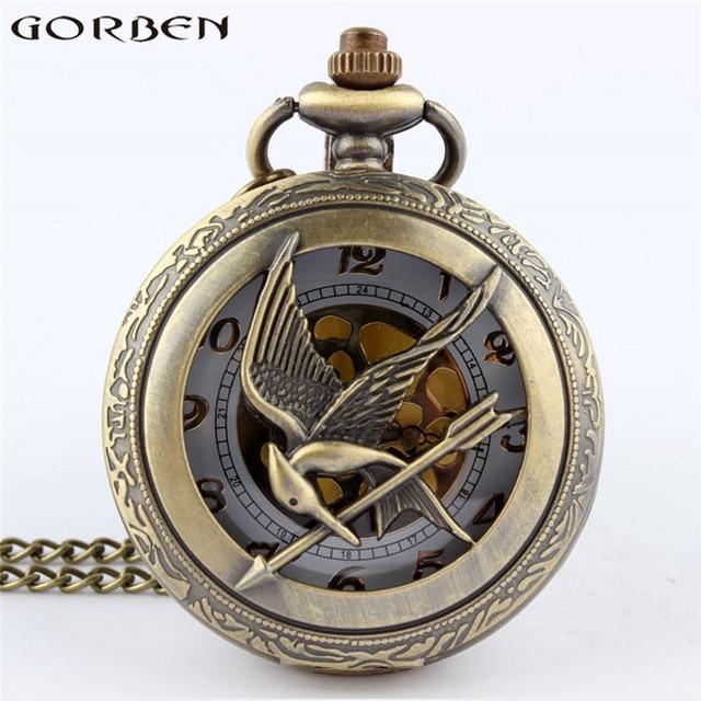 Retro Bronze The Hunger Games Hollow Quartz Pocket Watch Skeleton Bird Clock Pen