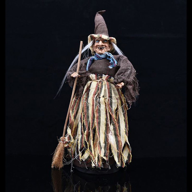 Witch With A Cauldron At The Door To Welcom Guests