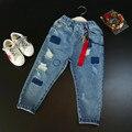 Детская одежда 2017 весной новые мальчики и девочки прилив пункт цвет ленты ослабление джинсы