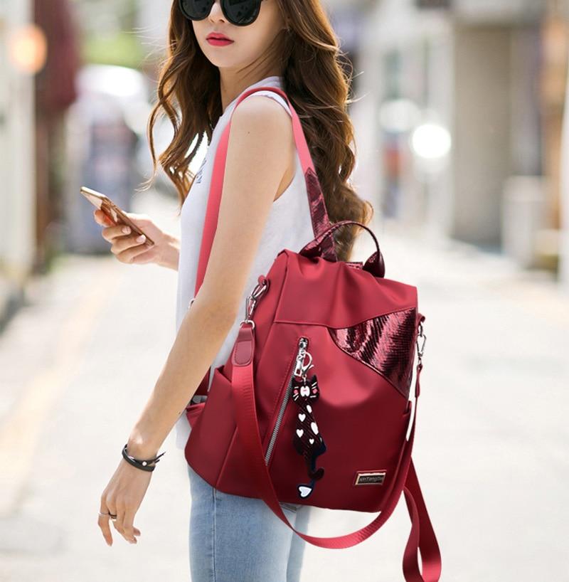 HTB1PIh3MjTpK1RjSZKPq6y3UpXaI Simple style ladies backpack anti-theft Oxford cloth tarpaulin stitching sequins juvenile college bag purse Bagpack Mochila