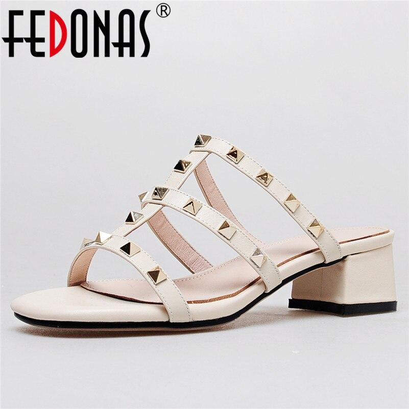 купить FEDONAS 1New Arrival Women Gladiator Sandals Genuine Leather Summer High Heels Shoes Woman Punk Rivet Party Wedding Slippers по цене 2843.66 рублей