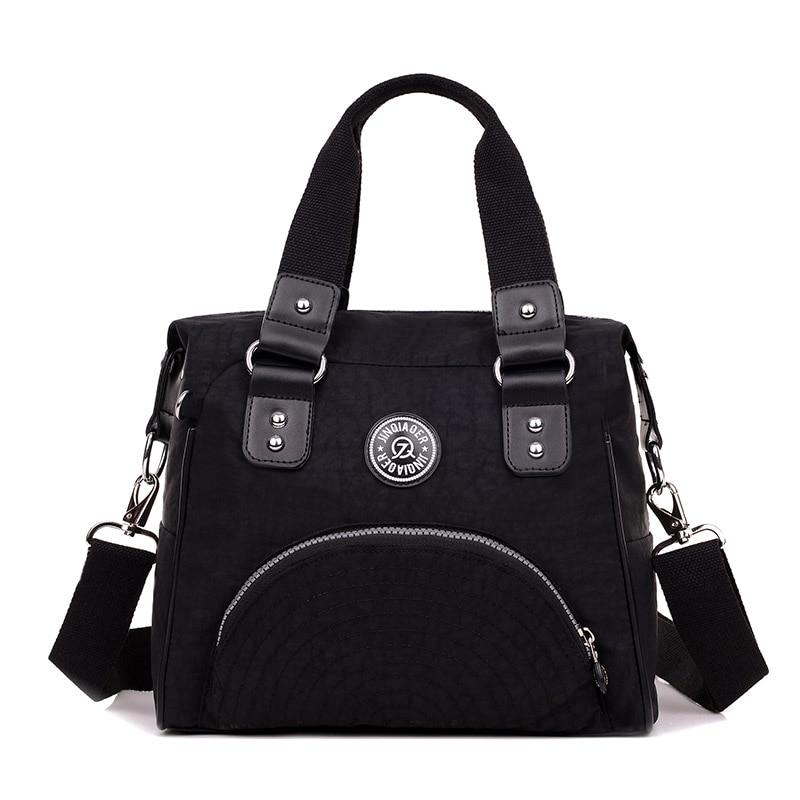 купить JINQIAOER 2018 new famous brand designers Women's tote Travel shoulder bag waterproof nylon handbag women messenger bags по цене 781.97 рублей