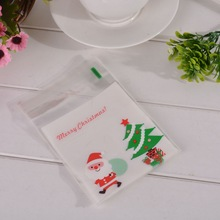 souarts 50PCs Christmas Self Sealing Bag Plastic Candy Cookies Pouches Gift Bag Self Adhesive Resealable Cellophane Poly Bags