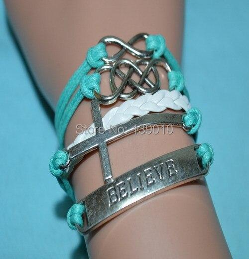 2ffc00b14b82 Blanco azul cuerda trenzada de cuero cruz BELIEVE Twine infinito Charms  gemelos brazaletes de la pulsera