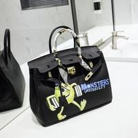 2016European designer high quality female bag contracted joker spoof hand drawn cartoons graffiti bag litchi grain portable 35CM