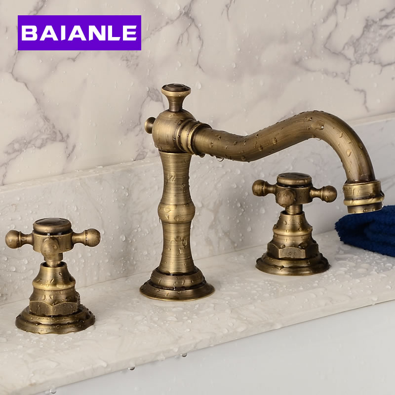 все цены на Deck Mounted Basin Faucet Three Holes Double Handles Widespread Bathroom Sink Faucet Antique Brass Finished Wash Basin Mixer Tap онлайн