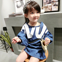 Children with long doll in cowboy long-sleeved T-shirt unlined upper garment of the girls dress new during the spring