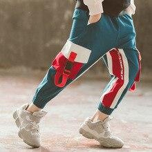 Spodnie chłopięce dorywczo spodnie sportowe z elastyczną talią dla dużego chłopca 8 12 13 lat koreańskie ubrania dla nastolatków bawełniane kieszenie dla dzieci luźne spodnie