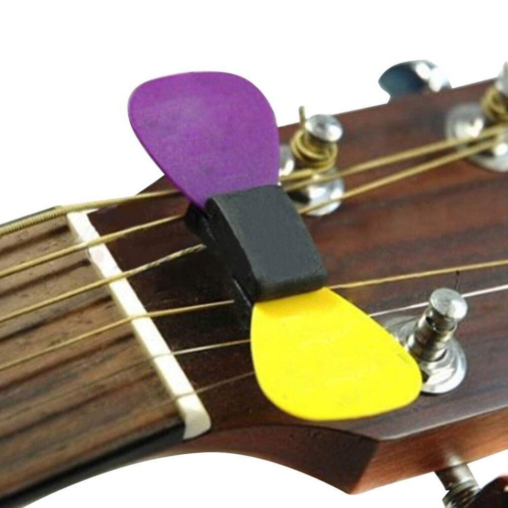 for guitar bass ukulele 1pc black rubber guitar pick holder fix on headstock in guitar parts. Black Bedroom Furniture Sets. Home Design Ideas