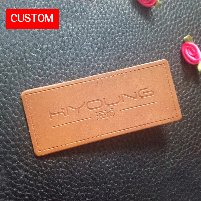 factory private customzied metal pu leather embossed logo sewing on