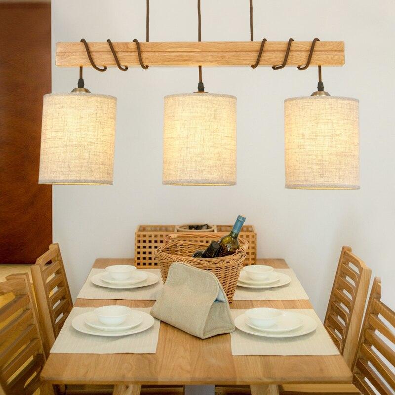 https://ae01.alicdn.com/kf/HTB1PRI1PVXXXXcwXpXXq6xXFXXXh/Nordic-Retro-Eetkamer-Hout-Hanglamp-3-Lights-Moderne-Art-Loft-Hotel-Bar-Keuken-Woonkamer-Verlichting-Lamp.jpg