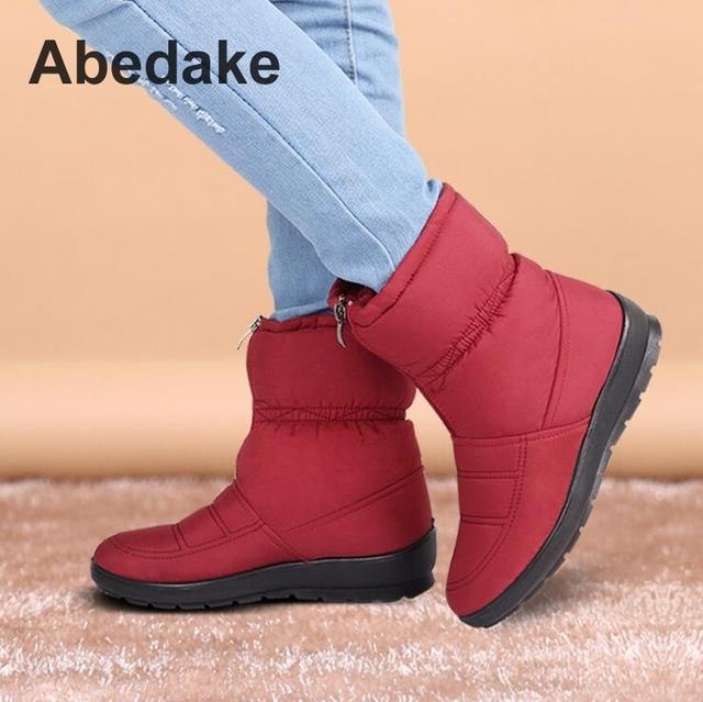 Botas de nieve 2016 Otoño mujer botas impermeables antideslizantes felpa corta cremallera zapatos de mujer de invierno más el tamaño de la madre de invierno botas