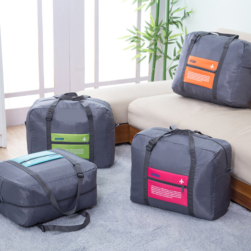 купить OKOKC Fashion WaterProof Travel Bag Large Capacity Bag Women Oxford Folding Bag Unisex Luggage Travel Handbags онлайн