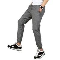 Moda Inverno sweatpants para homens hip hop preto sólido cinza calças basculador calças Outono masculino faixa de carga calças De Algodão suor 4XL