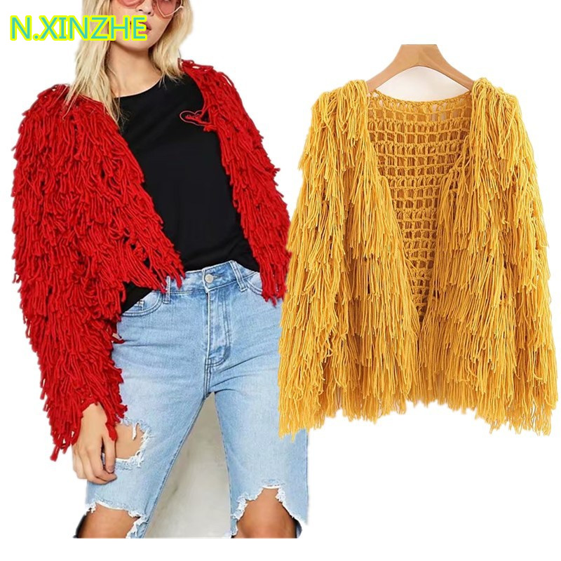 2018 women clothing long sleeve tassel hollow out solid hand knitted sweater Female fashion casual loose