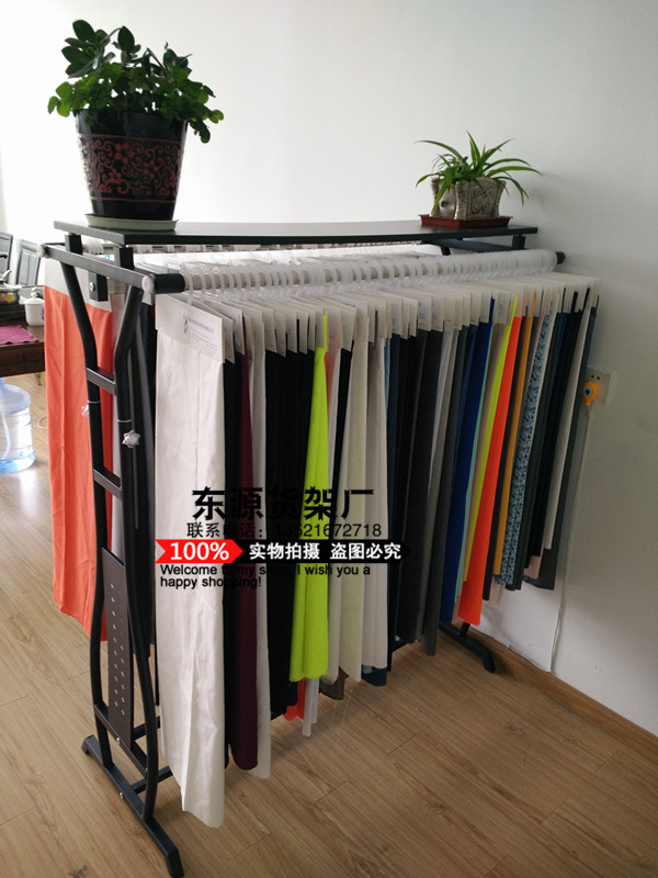 The parallel bars side hang clothes tree island show clothes shelves fall to the ground