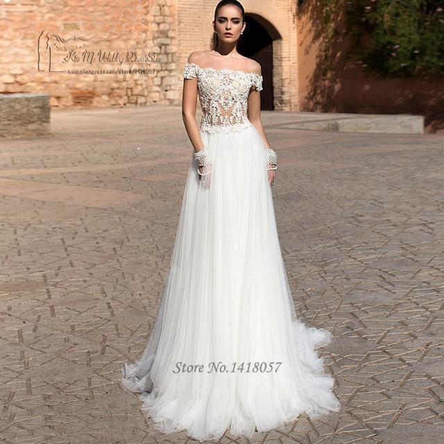 3fd41b0e9cf7b الهبي مثير فستان الزفاف انظر خلال الرباط أثواب الزفاف أفريقي 2017 قصيرة الأكمام  فساتين العروس عارية