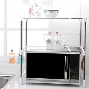Image 2 - Shuang Qing Verstellbare Edelstahl Mikrowelle Regal Abnehmbare Rack Küche Geschirr Regale Home Storage Rack 7009