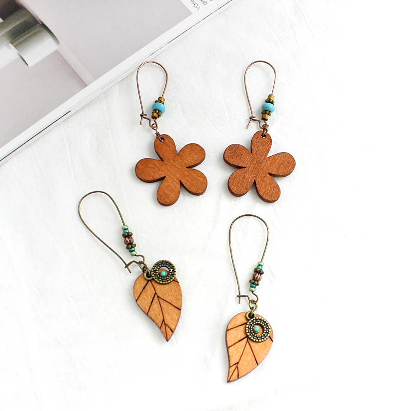Triangle teardrop five-leaf flower leaf wood shape fashion simple earrings suitable for temperament elegant female jewelry gift