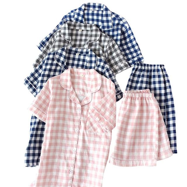 夏新男性と女性パジャマセットなスタイルのチェック柄の快適な綿のパジャマセット半袖 + ショーツホームウェアカジュアルウェア着用