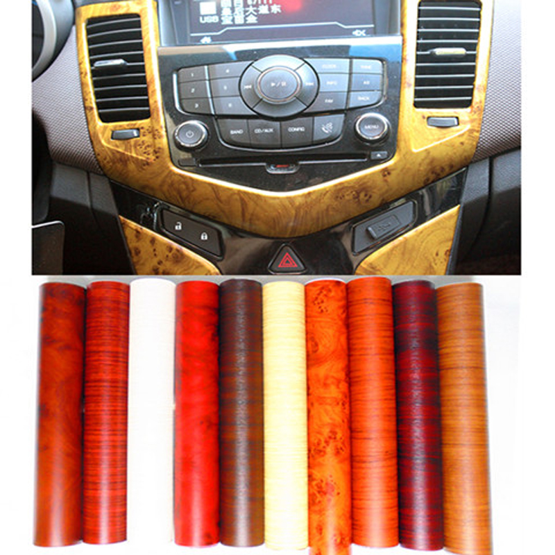Automotive wood grain adhesive strip